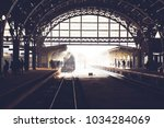 old locomotive stopped at the... | Shutterstock . vector #1034284069