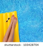 Woman Relaxing In A Pool   Fee...