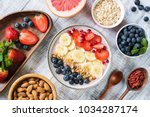 smoothie bowl with banana... | Shutterstock . vector #1034287174