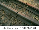 detail of old rusty rails in... | Shutterstock . vector #1034287198