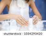 young woman choosing ring in... | Shutterstock . vector #1034293420