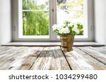 desk of free space with window... | Shutterstock . vector #1034299480