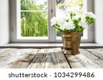 desk of free space with window... | Shutterstock . vector #1034299486