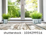 desk of free space with window... | Shutterstock . vector #1034299516