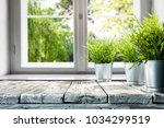 desk of free space with window... | Shutterstock . vector #1034299519