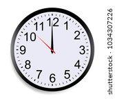 round clock face showing twelve ... | Shutterstock .eps vector #1034307226