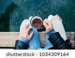 over shoulder shot of trendy... | Shutterstock . vector #1034309164