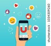 hand holding mobile smart phone ... | Shutterstock .eps vector #1034309260