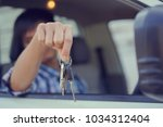 close up on driver man hand...   Shutterstock . vector #1034312404
