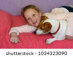 young girl age 8 9  hug jack... | Shutterstock . vector #1034323090