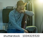 worried man sitting at gym and... | Shutterstock . vector #1034325520