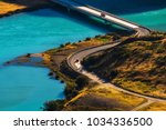 two cars crossing blue river on ... | Shutterstock . vector #1034336500