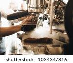 close up barista hands making... | Shutterstock . vector #1034347816