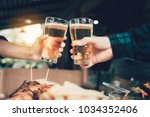 two friends toasting and... | Shutterstock . vector #1034352406