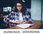 pensive african american... | Shutterstock . vector #1034352466