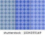 set of floral ornaments. blue... | Shutterstock .eps vector #1034355169