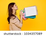 a woman with shopping bags | Shutterstock . vector #1034357089