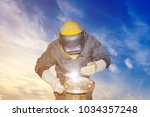 worker tig welding steel pipe... | Shutterstock . vector #1034357248
