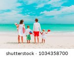 happy family with three kids... | Shutterstock . vector #1034358700