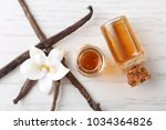 glass bottles with vanilla... | Shutterstock . vector #1034364826