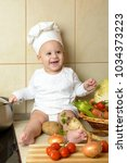 adorable baby boy in kitchen | Shutterstock . vector #1034373223