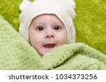 baby boy under the green towel | Shutterstock . vector #1034373256