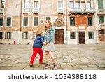 outdoor portrait of cute little ... | Shutterstock . vector #1034388118