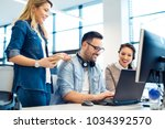 group of business people and... | Shutterstock . vector #1034392570