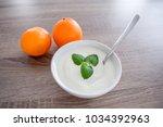 ceramic white bowl of white... | Shutterstock . vector #1034392963