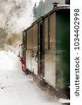 nostalgia railroad in winter  | Shutterstock . vector #1034402998