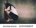 a woman sitting alone and... | Shutterstock . vector #1034408809