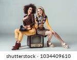 happy multicultural retro... | Shutterstock . vector #1034409610