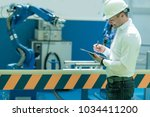 technology engineer working in... | Shutterstock . vector #1034411200