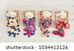 golden fresh waffles with... | Shutterstock . vector #1034413126