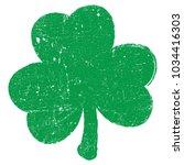 grunge clover shamrock leaf... | Shutterstock .eps vector #1034416303