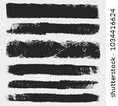 distressed bold brushes set.... | Shutterstock .eps vector #1034416624