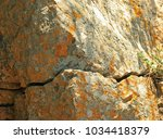 Crack In Rocks Covered Wit...d...