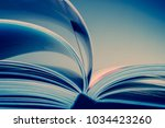 pages of an open book. blue... | Shutterstock . vector #1034423260