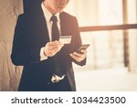 a business man standing and... | Shutterstock . vector #1034423500