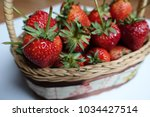 ripe strawberry in wooden... | Shutterstock . vector #1034427514