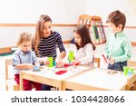 children play with kinetic sand | Shutterstock . vector #1034428066