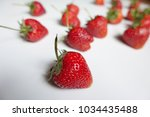 group of ripe strawberries on... | Shutterstock . vector #1034435488