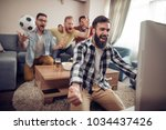 watching the big game sport... | Shutterstock . vector #1034437426