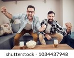 happy football fans drinking... | Shutterstock . vector #1034437948