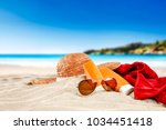 sunglasses on beach and free... | Shutterstock . vector #1034451418