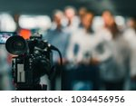 camera at media conference | Shutterstock . vector #1034456956