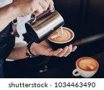 coffee latte art in coffee shop ... | Shutterstock . vector #1034463490