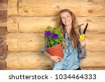 woman with a shovel  a rake and ... | Shutterstock . vector #1034464333