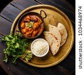 chicken tikka masala spicy... | Shutterstock . vector #1034468974