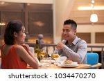 affectionate asian couple... | Shutterstock . vector #1034470270